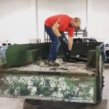 MILSPRAY's, Jason Martin, Special Projects working on a USMC 105 Trailer