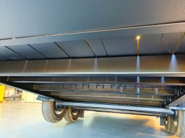 Trailer bed liner undercarriage